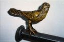 Second of Two Cast Bronze Birds for Forged Steel Curtain Rod
